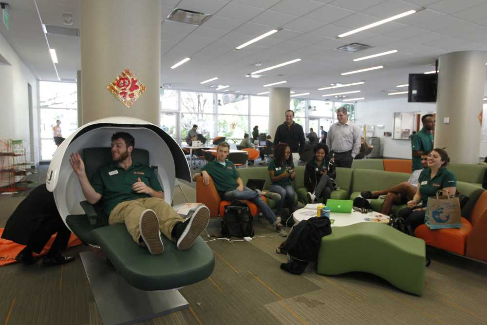 Students try out napping pods at the University of Miami. Courtesy of the University of Miami.