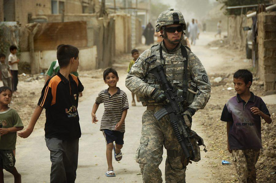 080804-A-8725H-341+%0A%0A++++++Iraqi+children+gather+around+as+U.S.+Army+Pfc.+Shane+Bordonado+patrols+the+streets+of+Al+Asiriyah%2C+Iraq%2C+on+Aug.+4%2C+2008.++Bordonado+is+assigned+to+2nd+Squadron%2C+14th+Cavalry+Regiment%2C+25th+Infantry+Division.++DoD+photo+by+Spc.+Daniel+Herrera%2C+U.S.+Army.++%28Released%29